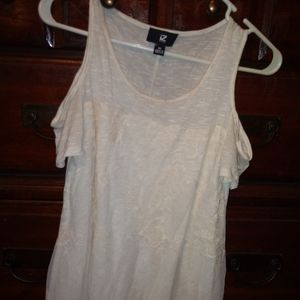 Cream cold shoulder top with lace overlay.
